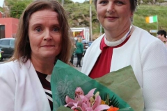 Triona Bonner (left) making a presentation to Cllr Noreen Mc Garvey who offcially opened the Burtonport festival.