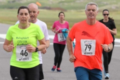 Mary Sweeney, Manus Sweeney and Teague Mc Cole on the runway at the Donegal Airport 5k.