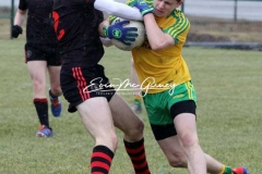 Donegal's Kyle Mc Nulty keeps possesion against Tyrone in Magheragallon on Saturday.