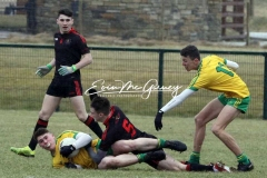 Aaron Neilan retains the ball against Tyrone in Magheragallon on Saturday.