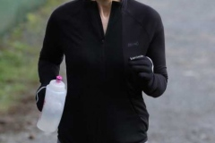 Michelle Bashford crossing the finish line at the 200th Dungloe Parkrun.