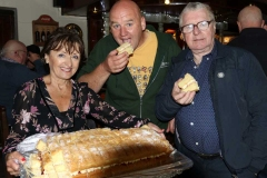 Cllr Michael Mac Giolla Easpuig and Eugene Sweeney sample some of Noreen Byrne's home baking at Feile Anagaire.
