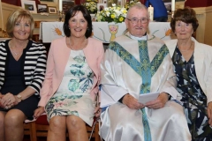 Fr Michael Herrity with sisters Madge, Catheriine and Mary and his golden jubilee celebration.