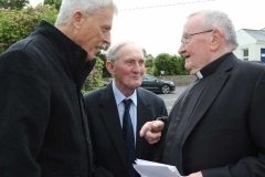 Fr Eddie Butler and Jimmy Durning chatting to Fr Michael Herrity in Knockfola at the weekend.