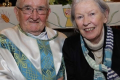 Bella Diver, who took Fr Herrity to school on his first day, pictured with him at his golden jubilee celebration.