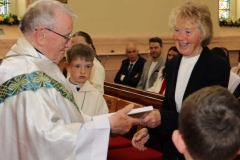 Brid Rodgers, Annagry bringing gifts to the altar at Fr Herrity's golden jubilee Mass.