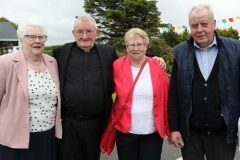 Brid Mc Garvey, Mary Boyle and Neily Mc Garvey with Fr Michael Herrity at the 50th anniversary celebrations of his ordination at the weekend.