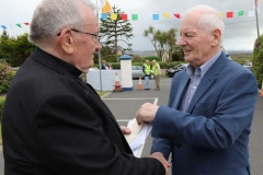 Fr Herrirty is greeted by former TD Dinny Mc Ginley at his golden jubilee celebration.