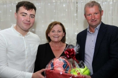 Siobhan Hunter and Packie Mc Hugh making a presentation to James Boyle (left) who officially opened the Maghery festival at the weekend. (Pictures by Eoin Mc Garvey)