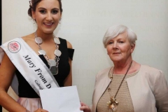 Mary Ward of the Mary from Dungloe Festival presenting a voucher from Mc Elhinneys to Roisin Maher, 2019 Mary from Dungloe winner.