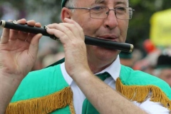 Eamon Rodgers of the Annagry band keeping in tune at the Mary parade. (Photos by Eoin Mc Garvey)