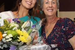 Festival chairperson Anthea Atkinson presenting flowers to the 2018 winner Caroline O'Donnell.