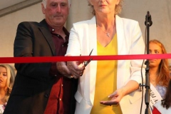 Tony and Anne Croke cut the ribbon to officially open the 2019 Mary from Dungloe International Arts Festival.