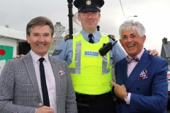 An arresting sight on Dungloe's main street as Garda Sergeant Rory Harrison meets up with Daniel O'Donnell and Noel Cunningham at the opening of the festival. (Photos by Eoin Mc Garvey)