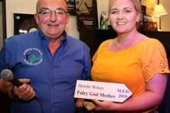 Kevin Bonner making a presentation this week to Deirdre Wilson who is one of the chaperones for the Marys at thiis year's festival.